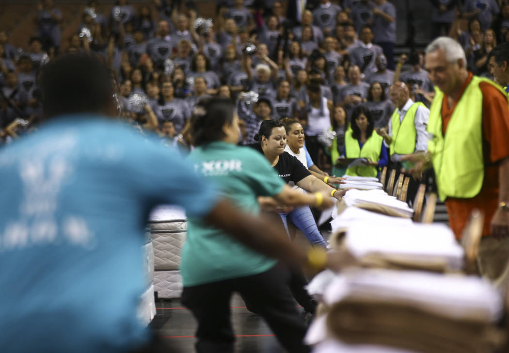 Competitors during the bed-making event as part of the Housekeeping Olympics at the Mandalay Bay Events Center in Las Vegas on Wednesday, Sept. 13, 2017. The competition drew teams from 17 differe ...
