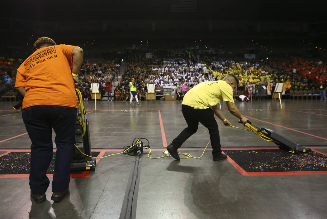 Yondy Moya of The Linq Hotel, right, during the vacuuming competition as part of the Housekeeping Olympics at the Mandalay Bay Events Center in Las Vegas on Wednesday, Sept. 13, 2017. The competit ...