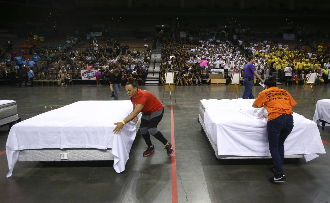 Alba Colon, left, of Red Rock Resort, and Josefina Moreno of Monte Carlo compete in the bed-making event during the Housekeeping Olympics at the Mandalay Bay Events Center in Las Vegas on Wednesda ...