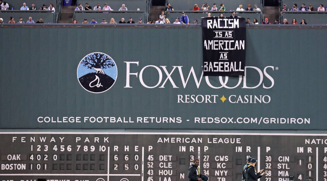 A banner is unfurled over the left field wall during the fourth inning of a baseball game between the Boston Red Sox and the Oakland Athletics at Fenway Park in Boston, Wednesday, Sept. 13, 2017.  ...