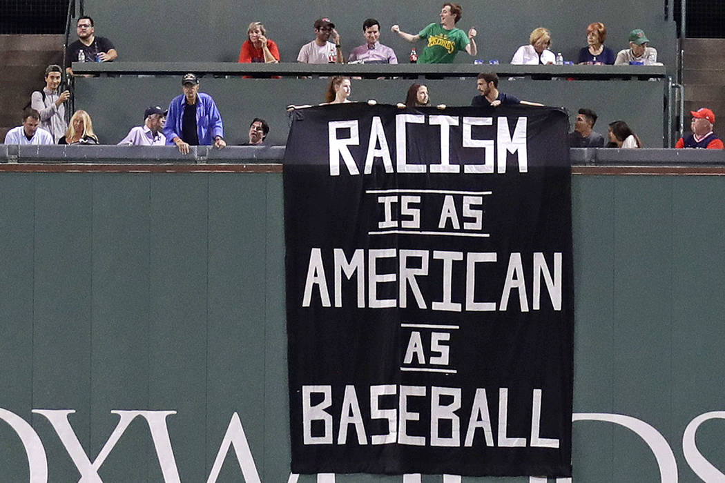 A banner is unfurled over the left field wall during the fourth inning of a baseball game between the Boston Red Sox and Oakland Athletics at Fenway Park in Boston, Wednesday, Sept. 13, 2017. (AP  ...