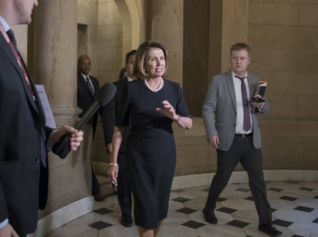 House Minority Leader Nancy Pelosi, D-Calif., leaves the office of House Speaker Paul Ryan on her way to meet with President Donald Trump to discuss a legislative solution for the Deferred Action  ...