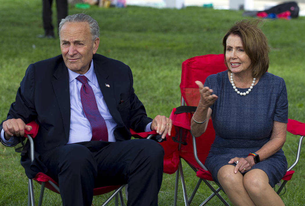 House Minority Leader Nancy Pelosi of Calif. accompanied by Senate Minority Leader Chuck Schumer of N.Y. speaks with DREAMERS who are holding a 4-day fast on Capitol Hill in Washington, Thursday,  ...