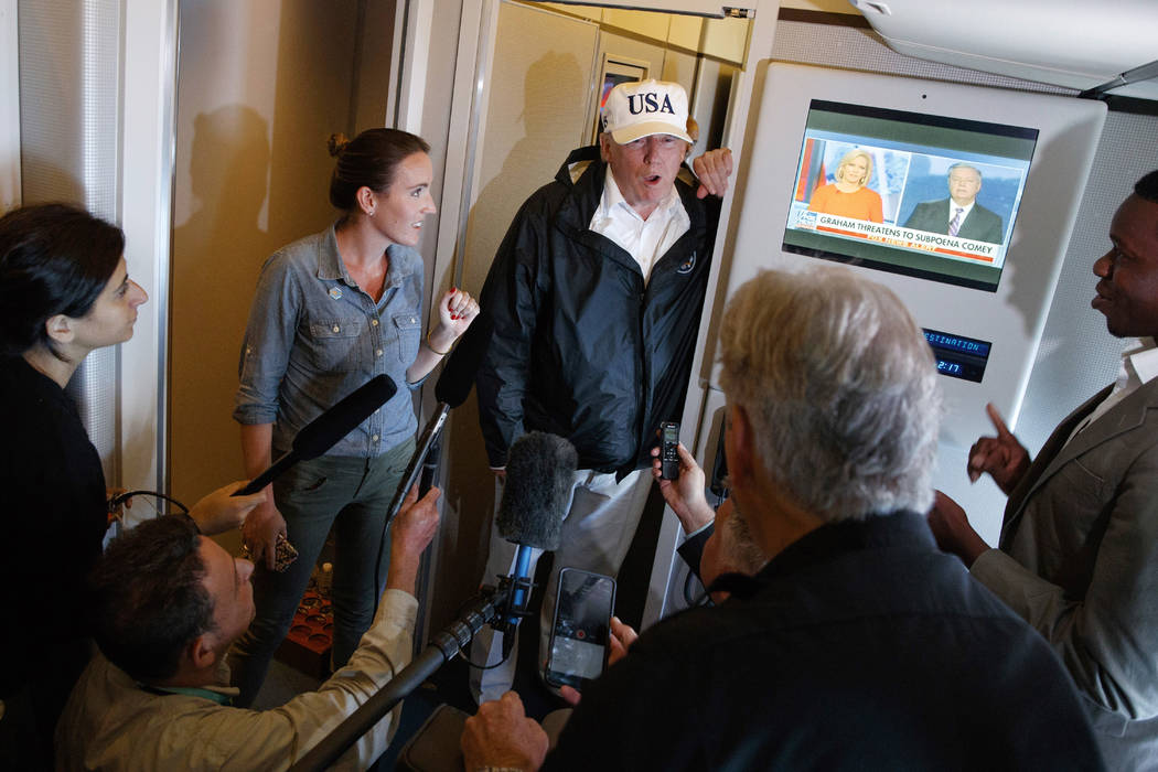 President Donald Trump talks with reporters aboard Air Force One, Thursday, Sept. 14, 2017, en route to Washington. (AP Photo/Evan Vucci)
