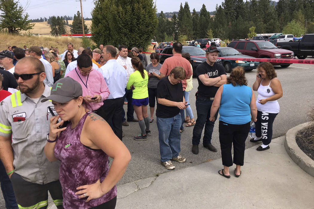 Parents gather in the parking lot behind Freeman High School in Rockford, Wash. to wait for their kids, after a deadly shooting at the high school Wednesday, Sept. 13, 2017. (Dan Pelle/The Spokesm ...