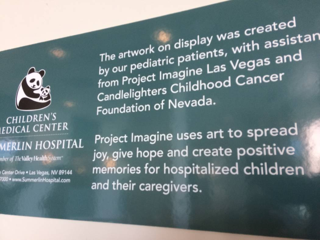A placard near Summerlin Hospital's lobby, seen Aug. 18, 2017, tells part of the story of the children's art. Project Imagine allows sick children to escape their circumstances through art, if ...