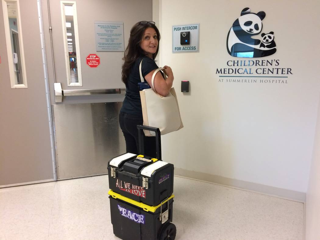 The Fairy Art Princess, as Diane Mifsud jokingly refers to herself, waits for admission into the pediatric unit at Summerlin Hospital Aug. 18, 2017. Project Imagine, her nonprofit, bring art to ch ...