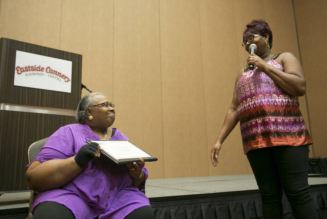 Family Self-Sufficiency Coordinator Emma Sanders, left, listens to a graduate LaShawnda Perry, right, during the Southern Nevada Regional Housing Authority's Family Self-Sufficiency Program gradua ...