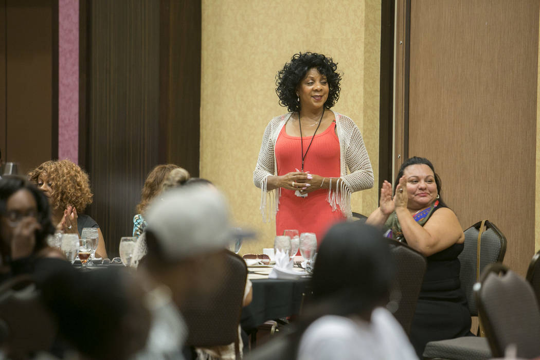 Family Self-Sufficiency Coordinator Essie Williams is recognized during the Southern Nevada Regional Housing Authority's Family Self-Sufficiency Program graduation luncheon at the Eastside Cannery ...