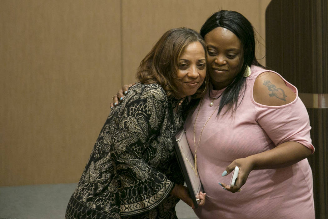 Family Self-Sufficiency Coordinator Paula Tucker, left, hugs a graduate Lenora Newell during the Southern Nevada Regional Housing Authority's Family Self-Sufficiency program graduation luncheon at ...