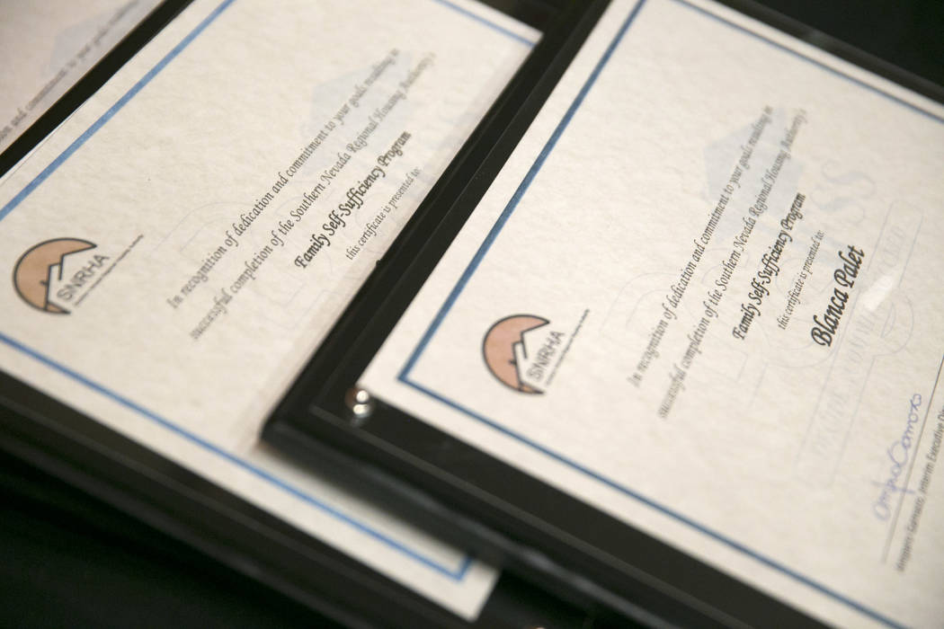 Family Self-Sufficiency Program certificates of completion during the Southern Nevada Regional Housing Authority's Family Self-Sufficiency program graduation luncheon at the Eastside Cannery in La ...