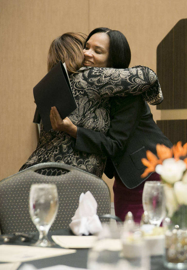 Family Self-Sufficiency Coordinator Paula Tucker, left, hugs a graduate Shantay Coleman during the Southern Nevada Regional Housing Authority's Family Self-Sufficiency program graduation luncheon  ...