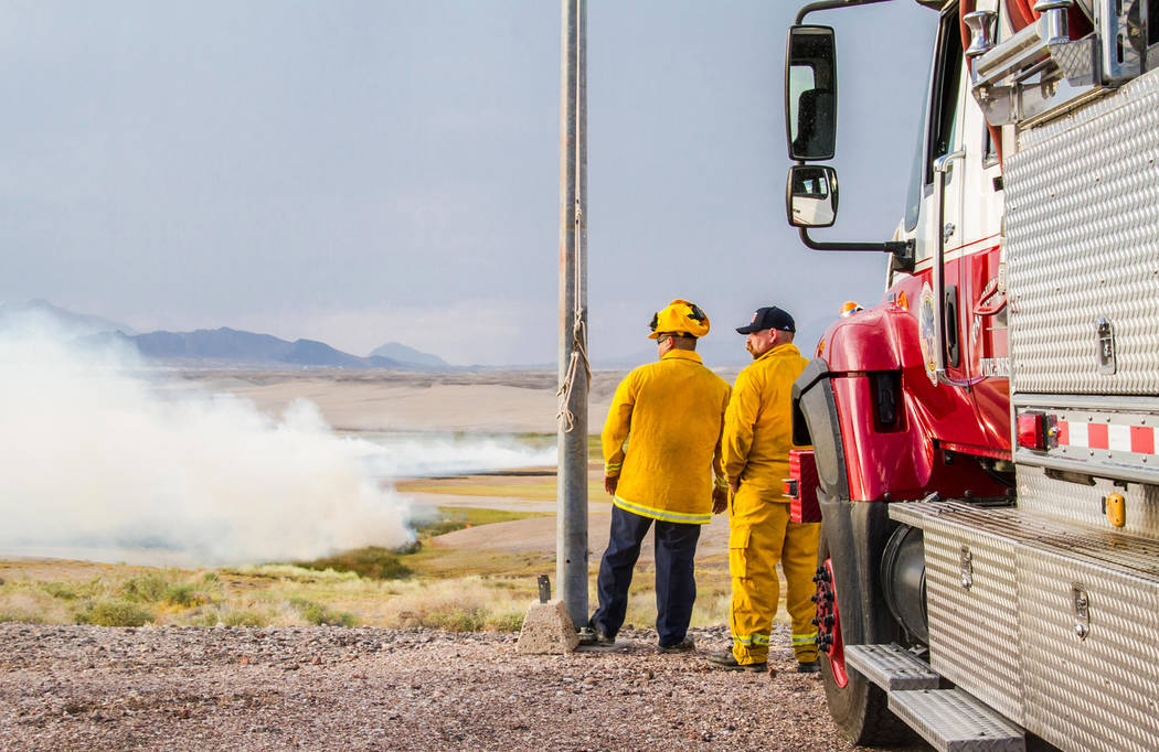 Firefighters battle a lightning-sparked wildfire near Tecopa, California, Monday. No structures were damaged, the fire did scorch about 27 acres of sensitive wetland habitat. (Nancy Good)