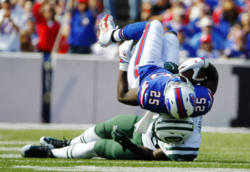 New York Jets' Demario Davis (56) tackles Buffalo Bills' LeSean McCoy (25) during the second half of an NFL football game, Sunday, Sept. 10, 2017, in Orchard Park, N.Y. (AP Photo/Jeffrey T. Barnes)