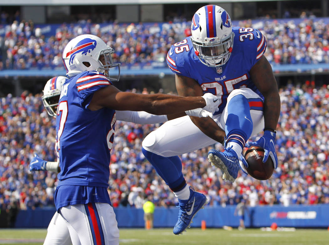 Buffalo Bills' Mike Tolbert (35) celebrates with teammate Jordan Matthews (87) after scoring a touchdown during the second half of an NFL football game against the New York Jets, Sunday, Sept. 10, ...