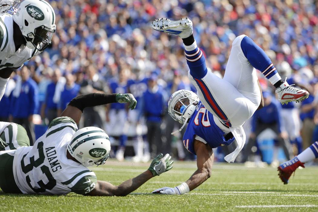 Buffalo Bills running back LeSean McCoy (25) is tackled by New York Jets' Jamal Adams (33) as Muhammad Wilkerson (96) watches during the second half of an NFL football game, Sunday, Sept. 10, 2017 ...