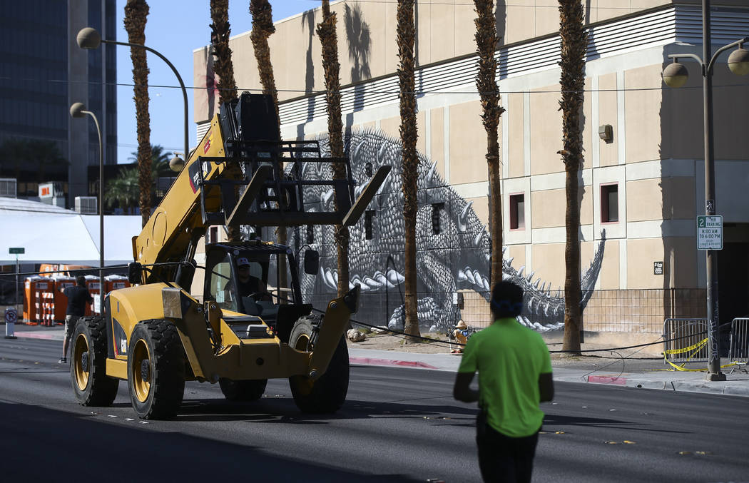 A heavy equipment vehicle after knocking down a power line along Stewart Avenue between 6th and 7th Streets in downtown Las Vegas as setup for the Life is Beautiful festival goes on on Thursday, S ...