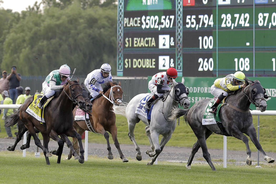 Ascend, ridden by Jose Ortiz, right, approaches the finish line to win the Woodford Reserve Manhattan at Belmont Park on Saturday, June 10, 2017, in Elmont, N.Y. (AP Photo/Julio Cortez)