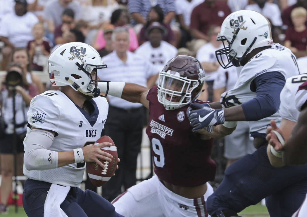 Mississippi State linebacker Montez Sweat (9) prepares to sack Charleston Southern quarterback Shane Bucenell (6) during the first half of an NCAA college football game in Starkville, Miss., Satur ...
