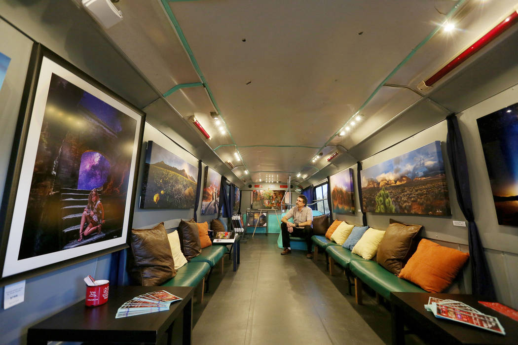 Artist and owner of Art Bus Coffee Steve Patchin in the gallery of his mobile double decker bus that acts as both an art gallery and a coffee shop, serving outside of Mailmax Mailing Solutions in  ...