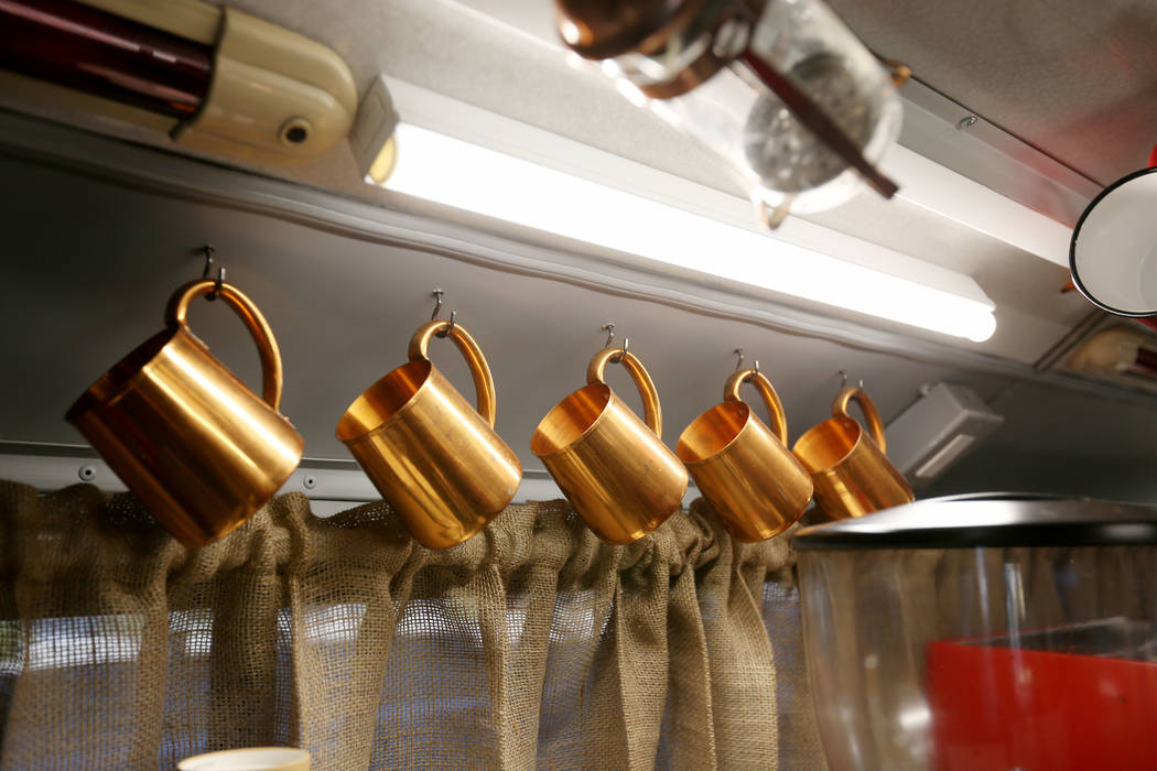 Mugs hang in the Art Bus Coffee, a double decker bus that acts as both an art gallery and a coffee shop, serving outside of Mailmax Mailing Solutions in Las Vegas, Thursday, Sept. 14, 207. Elizabe ...