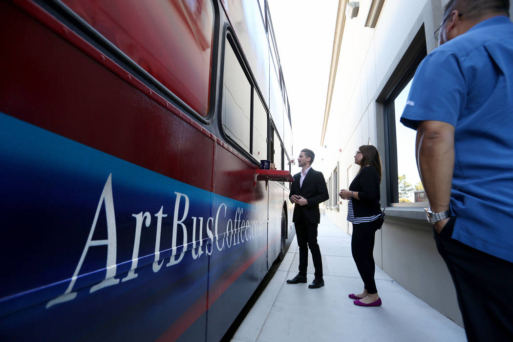 Mailmax Mailing Solutions employees Al Bunganich, left, and Susan Sutton choose their speciality coffee from Art Bus Coffee, a mobile double decker bus that acts as both an art gallery and a coffe ...