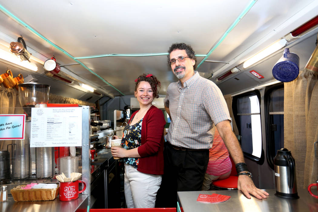 Barista Athena Patchin left, next to her dad, the artist and owner of Art Bus Coffee Steve Patchin, in the mobile double decker bus that acts as both an art gallery and a coffee shop, serving outs ...