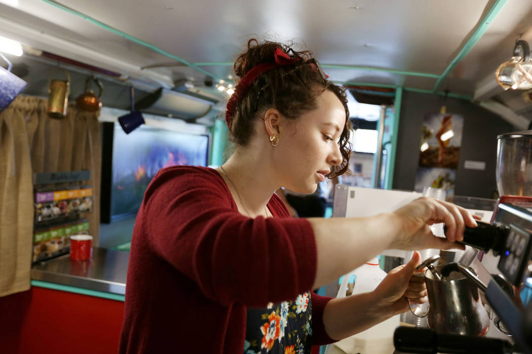 Art Bus Coffee barista Athena Patchin makes a speciality latte in the mobile art gallery and coffee shop, serving outside of Mailmax Mailing Solutions in Las Vegas, Thursday, Sept. 14, 207. Elizab ...