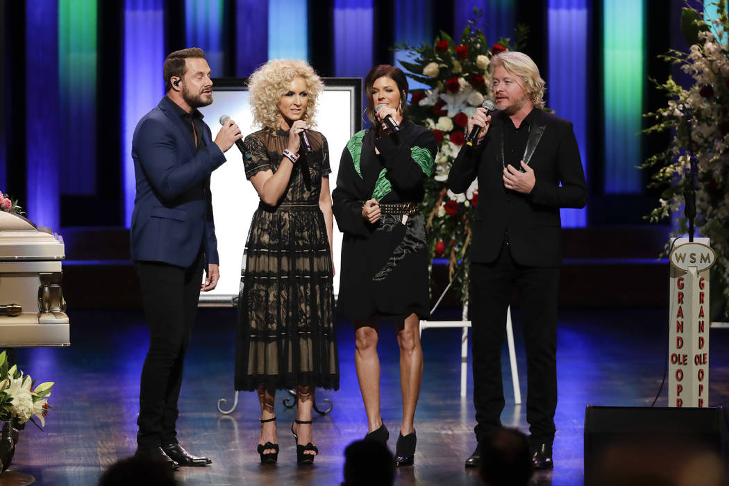The group Little Big Town, from left, Jimi Westbrook, Kimberly Schlapman, Karen Fairchild and Phillip Sweet, performs during a memorial service for country music singer Troy Gentry at the Grand Ol ...