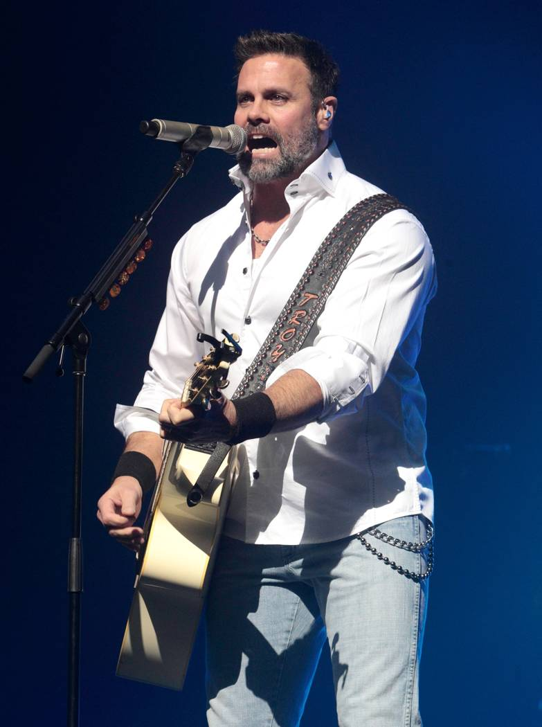 FILE - In this Jan. 17, 2013, file photo, Troy Gentry of the Country Music duo Montgomery Gentry performs on the Rebels On The Run Tour in Lancaster, Pa. Stars of the Grand Ole Opry will gather Th ...