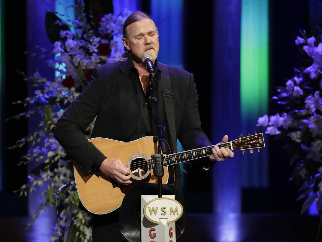 Trace Adkins performs during a memorial service for country music singer Troy Gentry at the Grand Ole Opry House Thursday, Sept. 14, 2017, in Nashville, Tenn. Gentry, who made up the duo Montgomer ...