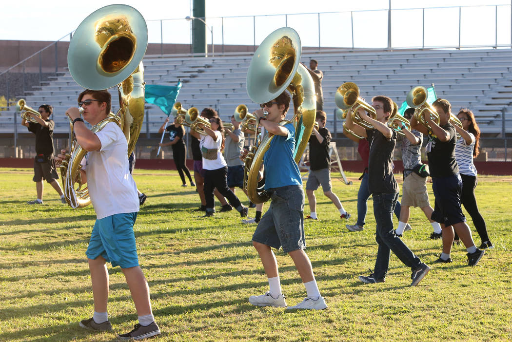 The Silverado High School marching band sousaphone players Hunter Ballinger, left, and Dante Chandler,  practice with the band on Thursday, Sept. 14, 2017, in Las Vegas. Bizuayehu Tesfaye Las Vega ...