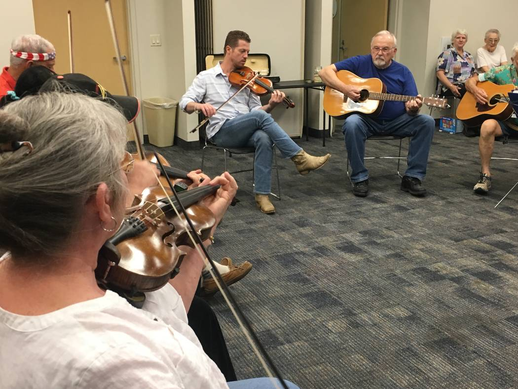 Members of NOFA aren't strictly fiddle players. At this jam on Sept. 13, there were five guitar players, six fiddlers, one bassist and even a mandolin player. (Diego Mendoza-Moyers/View) @dmendoza ...