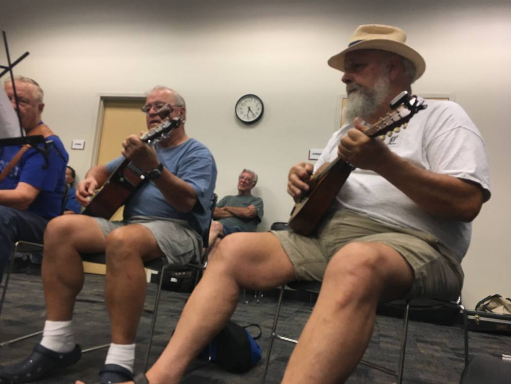 "Nevada Old-Time Fiddlers Association members Paul DePatta (right) and Terry Jobin wait as other members of the group choose the next song to be played during their ""open jam."" (Diego Mendoza-Moyer ..."