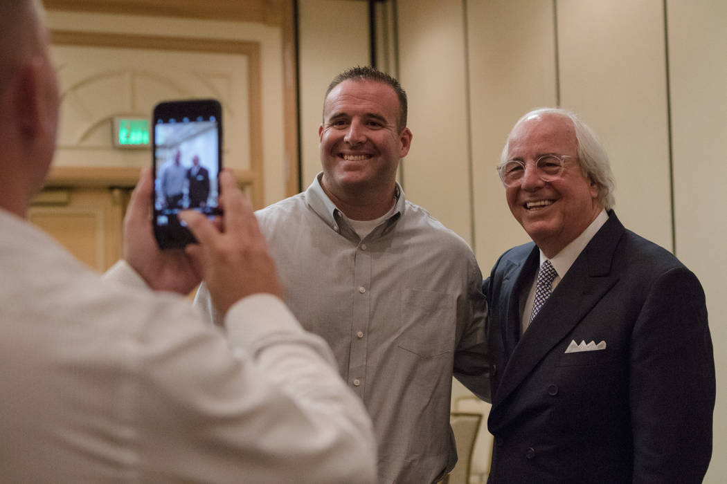 Ryan Jappe of the Henderson Police Department Fraud Division, center, takes a photo with Frank Abagnale on Thursday, Sep. 14, 2017, at the Gold Coast in Las Vegas. Morgan Lieberman Las Vegas Revie ...