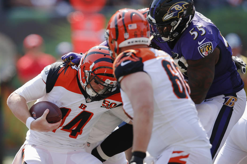 Baltimore Ravens outside linebacker Terrell Suggs (55) sacks Cincinnati Bengals quarterback Andy Dalton (14) in the second half of an NFL football game, Sunday, Sept. 10, 2017, in Cincinnati. (AP  ...