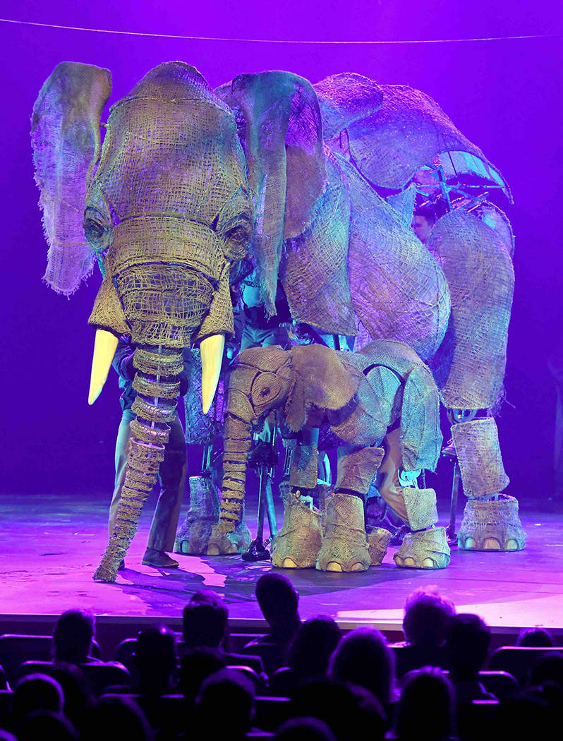 "Puppeteers perform with an elephant puppet named Queenie, left, and puppeteer Luke Chadwick-Jones operating a baby elephant puppet named Peanut during the opening night of ""Circus 1903"" at Paris L ..."
