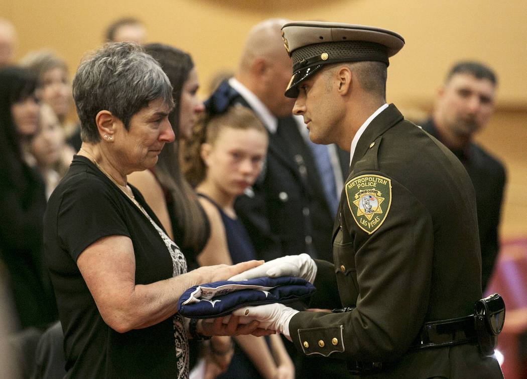 Lucille Datthyn, Las Vegas court bailiff William Datthyn's mother, is presented with a flag by the Las Vegas Metro Honor Guard during his memorial at Las Vegas City Hall,  Friday, Sept. 15, 2017.  ...