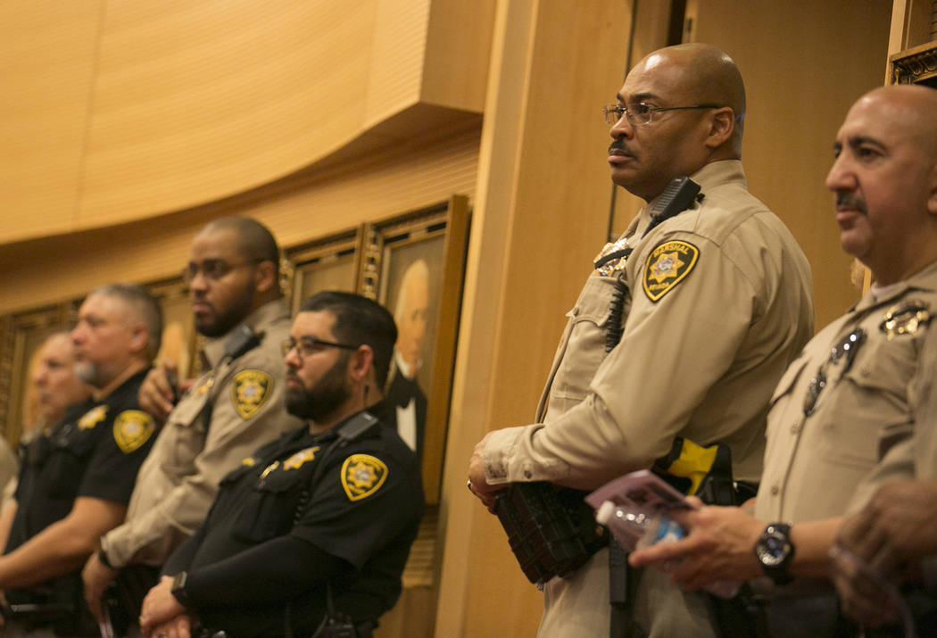 during a memorial for Las Vegas court bailiff William Datthyn, 45, at Las Vegas City Hall Friday, Sept. 15, 2017, in Las Vegas. Friends, family and coworkers gathered to remember Datthyn. Bridget  ...