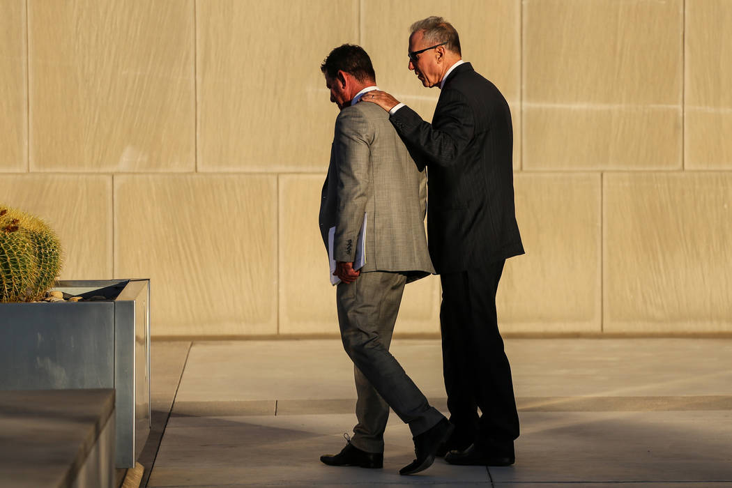 Attorney Todd Leventhal, left, and defendant Edward Levine, right, exit federal court after receiving a guilty verdict for selling endangered black rhino horns to a federal agent in Las Vegas, Thu ...