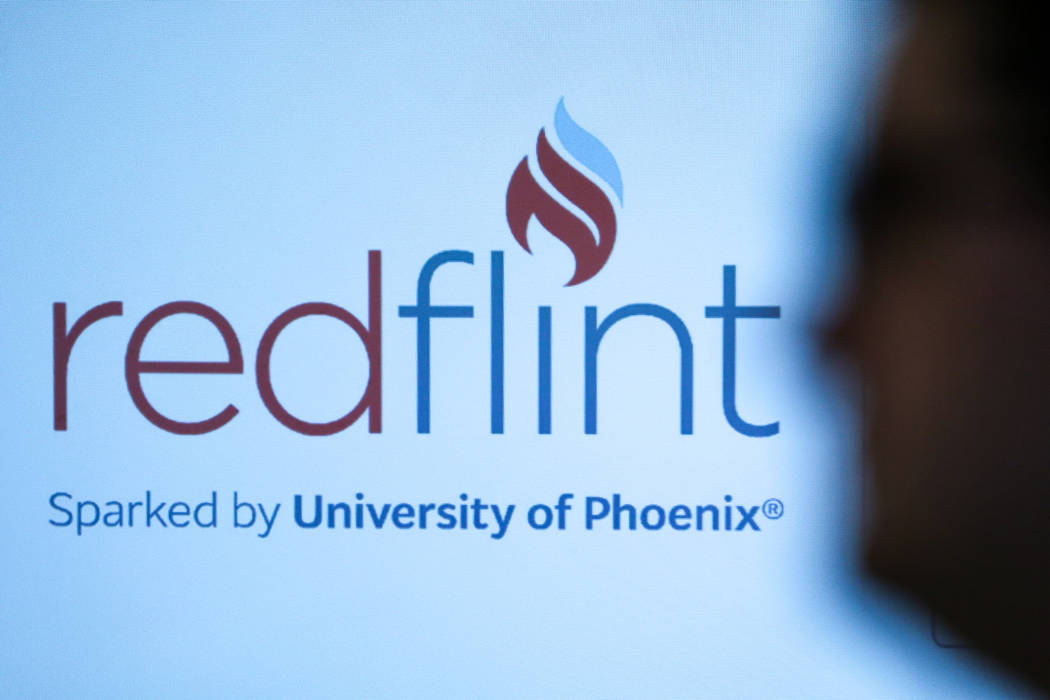 The RedFlint experience center logo is seen at one of their business strategy workshop in Las Vegas, Saturday, Sept. 16, 2017. Joel Angel Juarez Las Vegas Review-Journal @jajuarezphoto