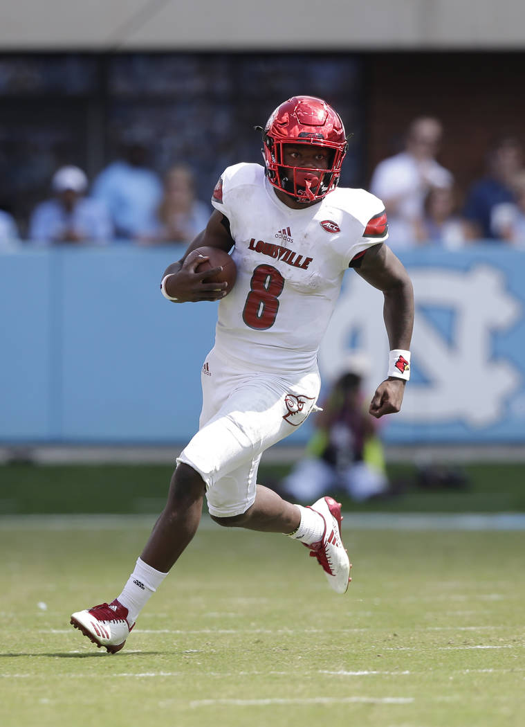 Louisville quarterback Lamar Jackson (8) runs against North Carolina during the first half of an NCAA college football game in Chapel Hill, N.C., Saturday, Sept. 9, 2017. (AP Photo/Gerry Broome)