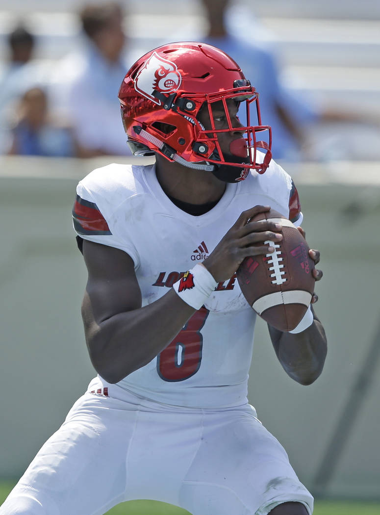 Louisville quarterback Lamar Jackson (8) looks to pass against North Carolina during the first half of an NCAA college football game in Chapel Hill, N.C., Saturday, Sept. 9, 2017. (AP Photo/Gerry  ...