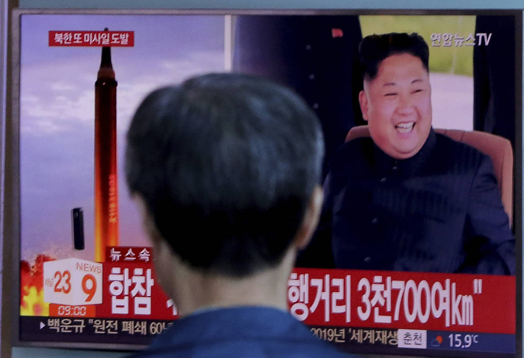 A man watches a TV screen showing a file footage of North Korea's missile launch and North Korean leader Kim Jong Un, at the Seoul Railway Station in Seoul, South Korea, Friday, Sept. 15, 2017. (A ...
