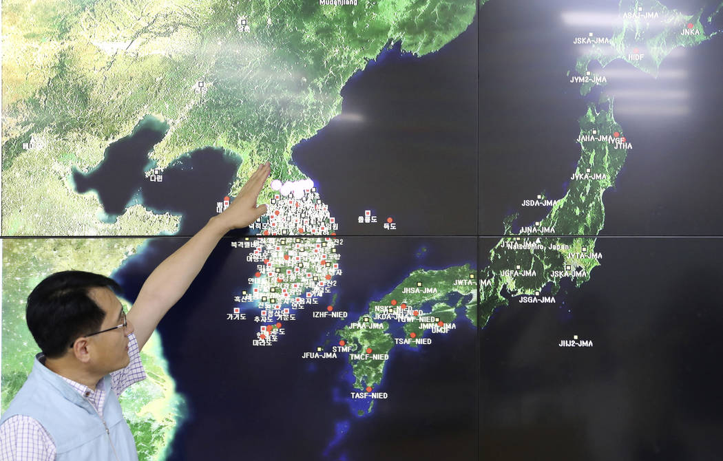 Earthquake and Volcano of the Korea Monitoring Division Director Ryoo Yong-gyu speaks to the media about North Korea's artificial earthquake with a map of the Korean peninsular in Seoul, South Kor ...