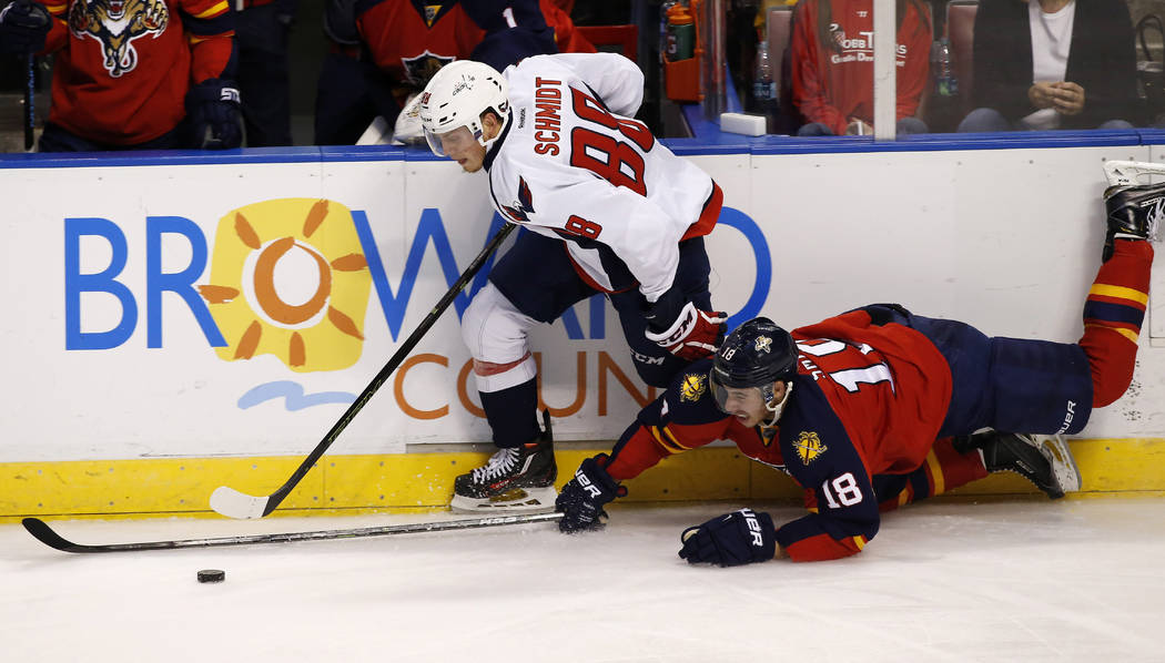 , Oct 31, 2015; Sunrise, FL, USA; Florida Panthers right wing Reilly Smith (18) and Washington Capitals defenseman Nate Schmidt (88) battle for the puck in the second period at BB&T Center. Ma ...