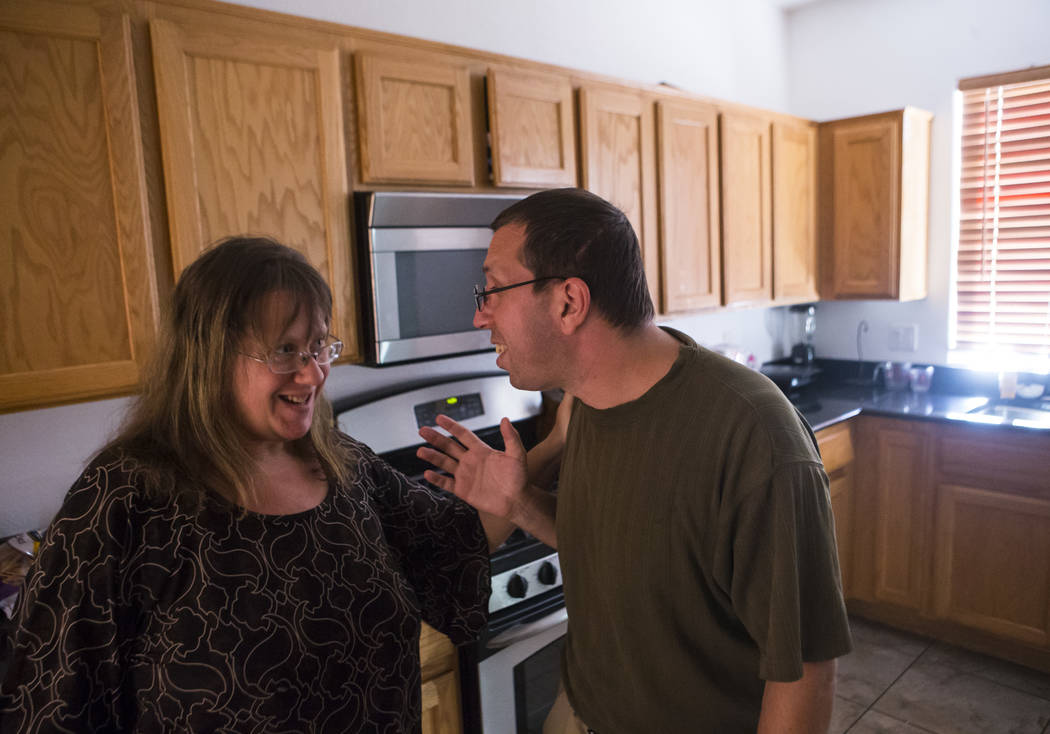 Matt and Caryn Minkowsky share a laugh at their home in northwest Las Vegas on Wednesday, Sept. 20, 2017. Matt currently has stage 2 brain cancer, and also underwent surgery to drain a cyst in his ...