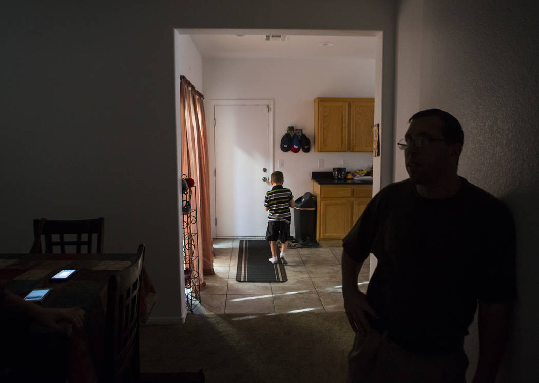 Matt Minkowsky, right, with son Brandon, 6, at their home in northwest Las Vegas on Wednesday, Sept. 20, 2017. Matt currently has stage 2 brain cancer, and also underwent surgery to drain a cyst i ...