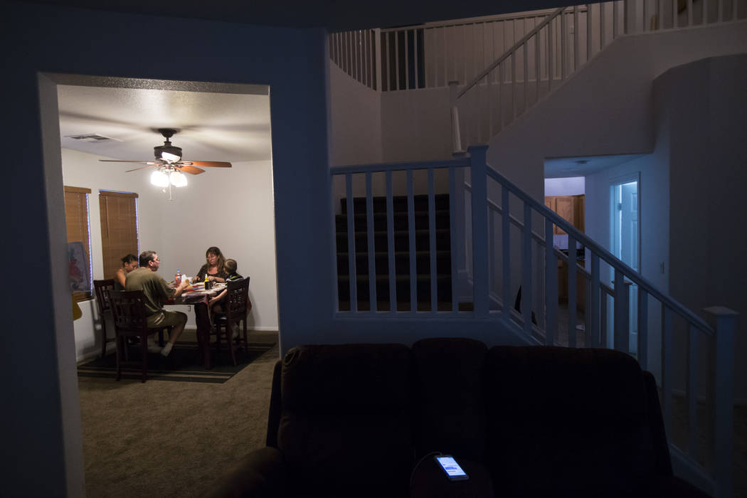 The Minkowsky family prepares dinner at their home in northwest Las Vegas on Wednesday, Sept. 20, 2017. Although the family receives just enough to get by from disability and food stamps, they str ...