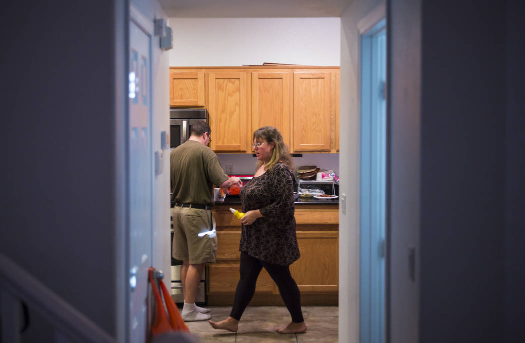 Matt and Caryn Minkowsky prepare dinner at their home in northwest Las Vegas on Wednesday, Sept. 20, 2017. Although the family receives just enough to get by from disability and food stamps, they  ...